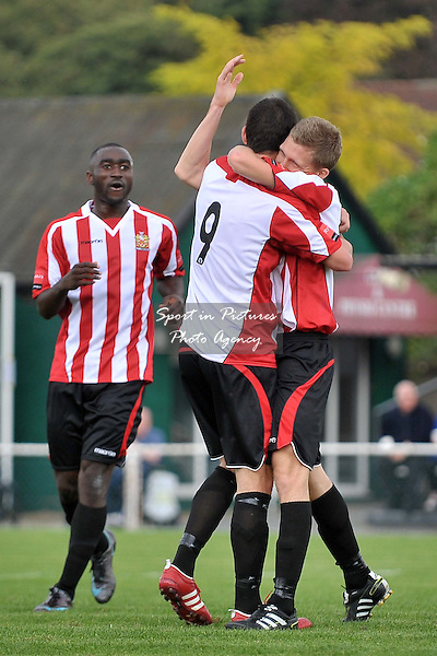 Goalscorer Lewis Smith (Hornchurch)is congratulated by Martin Tuohy (Hornchurch, 9), watched by Tambeson Eyong (Hornchurch). AFC Hornchurch Vs Wealdstone. Ryman Premier League. The Stadium. Essex. 24/09/2011. MANDATORY Credit Sportinpictures/Garry Bowden - NO UNAUTHORISED USE - 07837 394578.