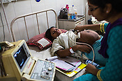 Dr. Cynthia Sharon conducts ultrasound for a pregnant woman at the maternity ward of the Duncan Hospital in Raxaul, Bihar, India.