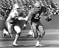 S.F. 49er Delvin Williams with Tampa Bay Buccaneers Dewey Selmon.<br /> (1977 photo/Ron Riesterer)