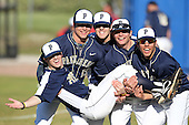 """Pittsburgh Panthers (L-R) Ray Black #15, Kevin Dooley #16, Cole Taylor #22, and Alex Caravella #32 hold up Matt Iannazzo #23 as their """"catch"""" before a game vs. the Central Michigan Chippewas at Chain of Lakes Park in Winter Haven, Florida;  March 11, 2011.  Pittsburgh defeated Central Michigan 19-2.  Photo By Mike Janes/Four Seam Images"""