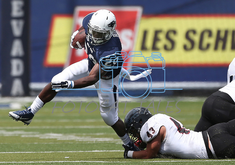 Nevada's James Butler (20) runs from Southern Utah defender Josh Kariya (43) during the first half of an NCAA college football game on Saturday, Aug. 30, 2014, in Reno, Nev. (AP Photo/Cathleen Allison)