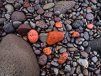 Colorful stones are plentiful at Pololu Valley's beach, Hawi, Big Island of Hawai'i.