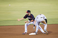 Christian Stringer (8) of the Kannapolis Intimidators loses the ball as Jeff Kemp (4) of the Delmarva Shorebirds kicked it out of his glove as he slid into second base at CMC-NorthEast Stadium on July 3, 2014 in Kannapolis, North Carolina.  The Shorebirds defeated the Intimidators 6-5. (Brian Westerholt/Four Seam Images)