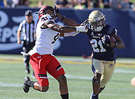 Annapolis, MD - September 23, 2017: Navy Midshipmen running back Tre Walker (21) stiff arms Cincinnati Bearcats cornerback Linden Stephens (9) during the game between Cincinnati and Navy at  Navy-Marine Corps Memorial Stadium in Annapolis, MD.   (Photo by Elliott Brown/Media Images International)