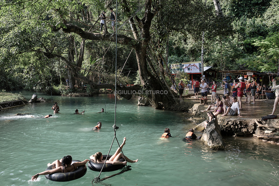 LAOS, NOVEMBER 2015<br />Blue Lagoon on of the touristic spot in Laos<br />Vang Vieng, until recently was sort of a Disneyland of drugs, sex and adrenaline for backpackers, today has become a holiday resort for families Korean and Chinese or neo trendsetters who worship the trendy new baguette bars.@Giulio Di Sturco