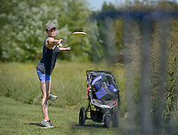 NWA Democrat-Gazette/BEN GOFF @NWABENGOFF<br /> Lacey Mitchell of Bentonville takes a shot on Sunday Sept. 13, 2015 while playing a round at the Twin Creeks Disc Golf Course in Rogers.
