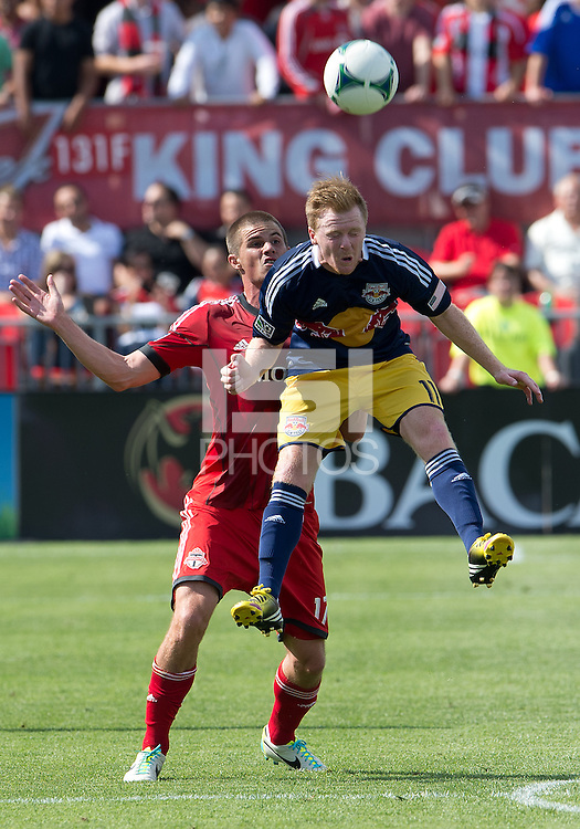 20 July 2013: Toronto FC forward Justin Braun #17 and New York Red Bulls midfielder Dax McCarty #11in action during an MLS regular season game between the New York Red Bulls and Toronto FC at BMO Field in Toronto, Ontario Canada.