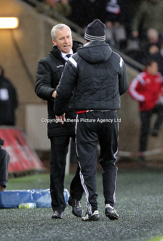 (L-R) Crystal Palace manager Alan Pardew greets Swansea head coach Francesco Guidolin after the end of the Barclays Premier League match between Swansea City and Crystal Palace at the Liberty Stadium, Swansea on February 06 2016
