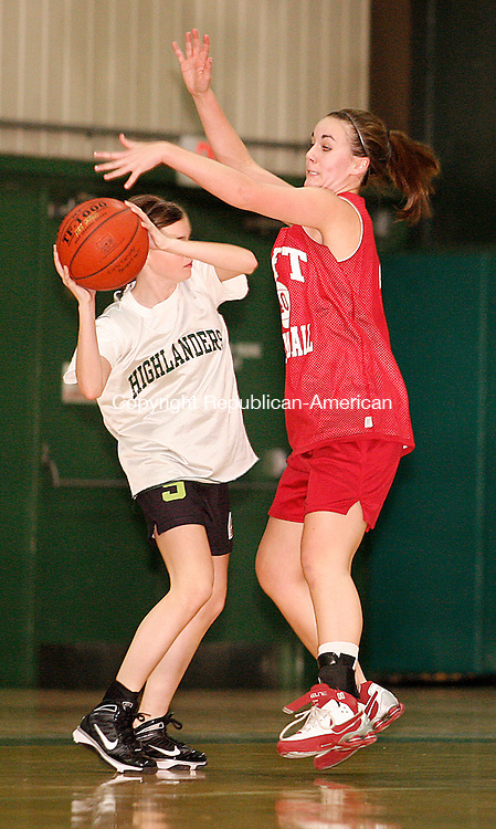Waterbury, CT-02, December 2009-120209CM03 --  Chase Collegiate's Allysa Longo looks for an open teammate, while Taft's Sarah Perda's applies defensive pressure.  Chase hosted Taft Wednesday afternoon at the Goss Fieldhouse at the Chase School in Waterbury.       Christopher Massa Republican-American