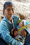 Vorng Sary holds her baby in the village of Thmar Dat in northern Cambodia. Following devastating 2011 floods in the village, Church World Service and Dan Church Aid, both members of the ACT Alliance, helped villagers to recover their homes and livelihoods.