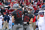 Erik Powell (46) and Kaleb Fossum (83) celebrate a successful kick during the Washington State Cougars Pac-12 Conference demolition of the Arizona Wildcats, 69-7, on November 5, 2016, at Martin Stadium in Pullman, Washington.