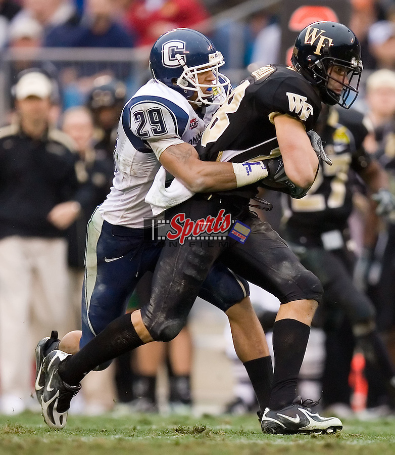 Wake Forest wide receiver Chip Brinkman (88) is tackled from behind by Connecticut cornerback Tyvon Branch (29) at the Meineke Car Care Bowl Saturday, December 29, 2007 in Charlotte, NC.