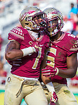 Florida State redshirt senior running back Ryan Green (7) celebrates his first touchdown as a Seminole with teammate Tre McKitty in the 2nd half of an NCAA college football game in Tallahassee, Fla., Saturday, Dec. 2, 2017. Florida State defeated Louisiana Monroe  (AP Photo/Mark Wallheiser)