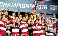 The Wigan Warriors team holds the trophy aloft<br /> <br /> Photographer Alex Dodd/CameraSport<br /> <br /> Betfred Super League Grand Final - Wigan Warriors v Warrington Wolves - Saturday 13th October 2018 - Old Trafford - Manchester<br /> <br /> World Copyright &copy; 2018 CameraSport. All rights reserved. 43 Linden Ave. Countesthorpe. Leicester. England. LE8 5PG - Tel: +44 (0) 116 277 4147 - admin@camerasport.com - www.camerasport.com