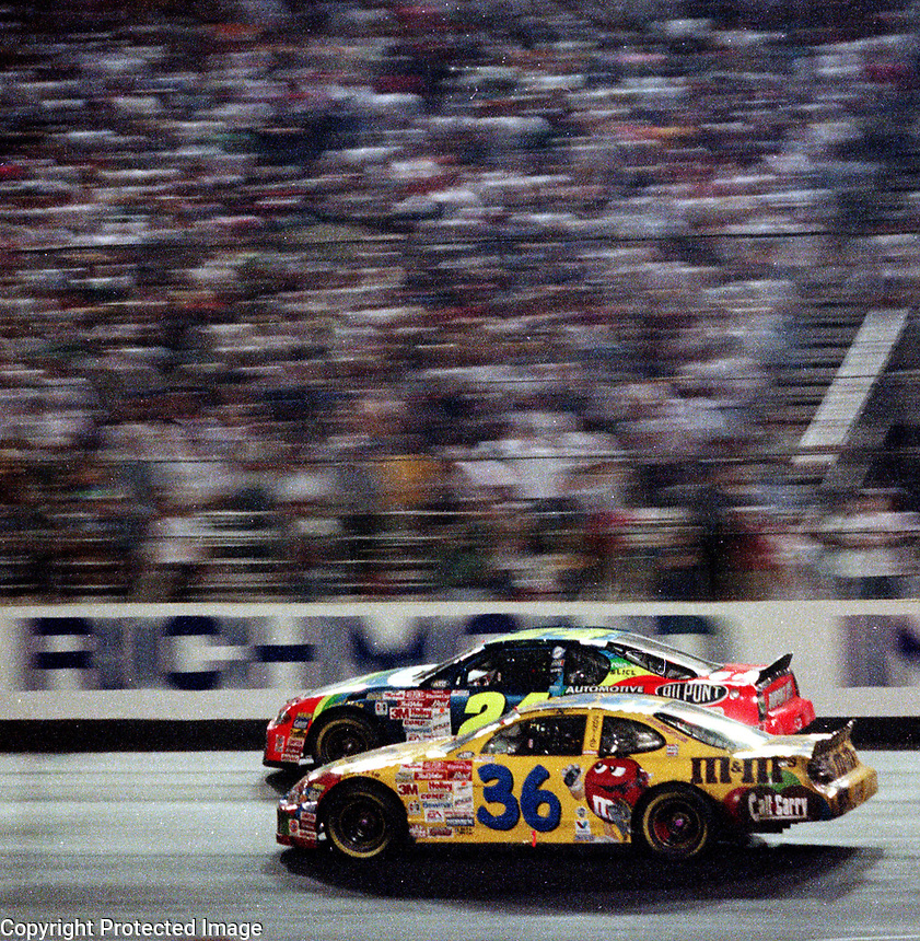 Jeff Gordon passes Ken Schrader (#36) enroute to victory in  the Chevrolet Monte Carlo 400 NASCAR Winston Cup race at Richmond International Raceway in Richmond, VA on Saturday night, 9/9/00.  The race was won by Gordon.(Photo by Brian Cleary)