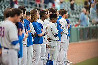 Midland RockHounds players face the American flag during the singing of the national anthem on May 6, 2019, at Arvest Ballpark in Springdale, Arkansas. (Jason Ivester/Four Seam Images)