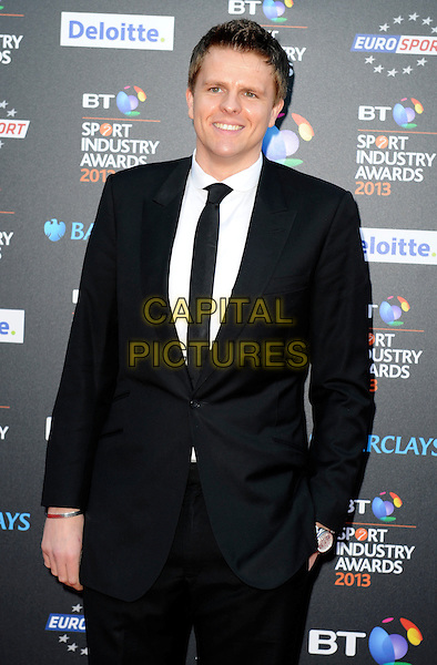 Jake Humphrey.Attending the BT Sport Industry Awards at Battersea Evolution, London, England, UK, May 2nd 2013..half length black suit tie white shirt hand in pocket .CAP/PP/GM.©Gary Mitchell/PP/Capital Pictures