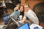 Bella Garofalo, left, and Anne Florence Brown cut up while studying.  Photo by Kevin Bain/University Communications Photography
