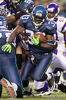 Seattle Seahawks running back Leon Washington (33) takes the ball upfield in a game against the Minnesota Vikings at CenturyLink Field in Seattle, Washington.