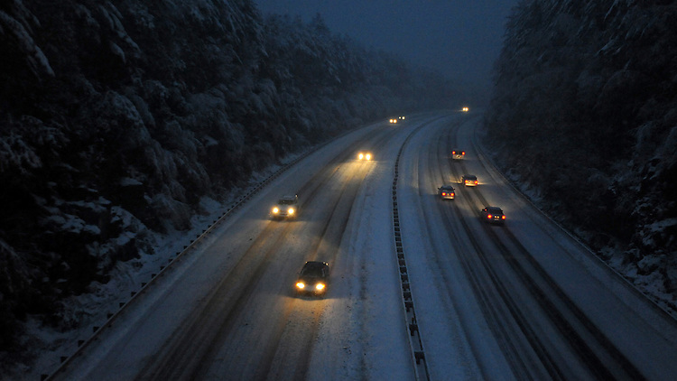 Motorist drive on a snow covered Masspike on Saturday, October 29, 2011.