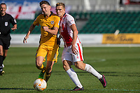 Mark Randall of Newport County and Danny Wright of Cheltenham during the Sky Bet League 2 match between Newport County and Cheltenham Town at Rodney Parade, Newport, Wales on 10 September 2016. Photo by Mark  Hawkins / PRiME Media Images.