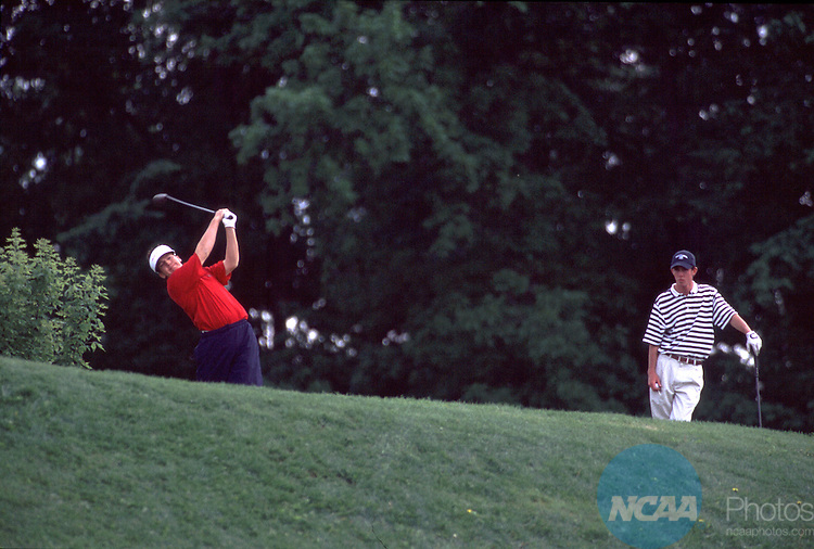 25 MAY 2001: Kevin Warrick of the University of West Florida watches as Steve Sokol of Florida Southern College shoots during the 2001 Division II Men's Golf Championship held at The Meadows Golf Course on the campus of Grand Valley State University in Allendale, MI.  Sokol won the overall individual final and Warrick tied for second.  John A. Lacko/NCAA Photos.