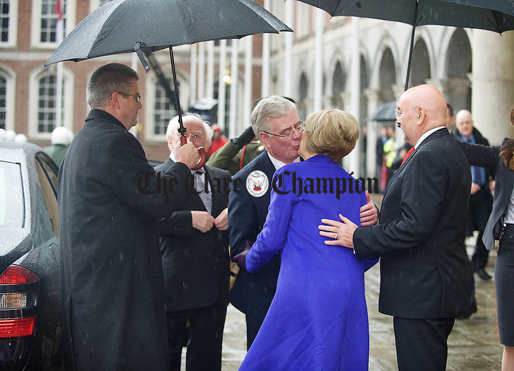 President elect Michael D. Higgins and his wife Sabina arrive for the inauguration and are greeted by Tanaiste Eamon Gilmore and Labour's Ruairi Quinn at Dublin Castle. Photograph by John Kelly.