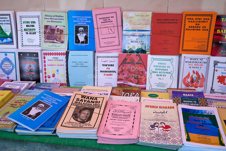 Stone Town, Zanzibar, Tanzania.  Islamic instruction books in Swahili and Arabic on sale outside Jibril mosque.  The book (center left) about Neil Armstrong says that he heard the Muslim call to prayer on the moon.