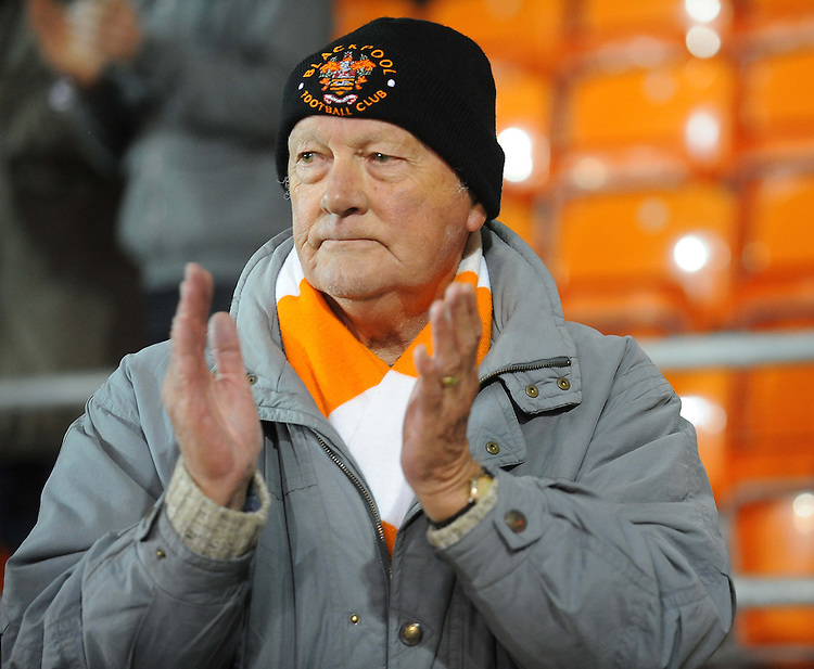 A Blackpool fan applauds his side at the final whistle<br /> <br /> Photographer Kevin Barnes/CameraSport<br /> <br /> Football - The Football League Sky Bet Championship - Blackpool v Birmingham City - Saturday 6th December 2014 - Bloomfield Road - Blackpool<br /> <br /> &copy; CameraSport - 43 Linden Ave. Countesthorpe. Leicester. England. LE8 5PG - Tel: +44 (0) 116 277 4147 - admin@camerasport.com - www.camerasport.com