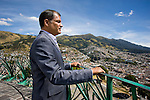 President Correa of Ecuador looks over Quito from observation platform in Giant Angel monument
