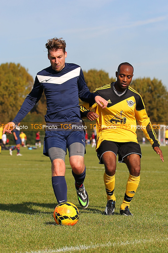 Bocca Albion (blue/white) vs Boroughs United - Hackney & Leyton Sunday League Football at South Marsh, Hackney Marshes, London - 05/10/14 - MANDATORY CREDIT: Gavin Ellis/TGSPHOTO - Self billing applies where appropriate - contact@tgsphoto.co.uk - NO UNPAID USE