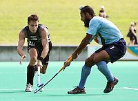 India's Rajpal Singh tackles James Nation during the international hockey match between the New Zealand Black Sticks and India at National Hockey Stadium, Wellington, New Zealand on Saturday, 20 February 2009. Photo: Dave Lintott / lintottphoto.co.nz