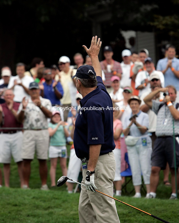 CROMWELL, CT 24 AUGUST 2005 082405BZ06- UConn Huskies mens basketball head coach Jim Calhoun waves to the crowd before teeing off<br /> during the St Paul Travelers Celebrity Pro-Am at the Buick Championship at the TPC at River Highlands Wednesday afternoon. <br /> Jamison C. Bazinet / Republican-American