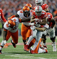Ohio State Buckeyes running back J.K. Dobbins (2) runs in the second quarter against Illinois Fighting Illini defensive lineman Tito Odenigbo (94) and Illinois Fighting Illini defensive lineman Tymir Oliver (96)  at Ohio Stadium November 18, 2017. [Eric Albrecht/Dispatch]