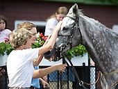 Janet Elliot pats Dalucci after taking a training flat race at the Saratoga Open House.