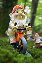 29/05/15<br /> <br /> Pedal-power gnome.<br /> <br /> For one group of hardy folk, today's rain only adds to the fun that can be had by the beach, fishing in the river, or playing in the woods.<br /> <br /> The gnomes, and a few pixies and fairies, make up a collection, now believed to be close to 2,000 individuals, that 'live' at the Gnome Reserve near Bideford, North Devon.<br /> <br /> Visitors are asked to wear gnome hats, so as not to scare the gnomes who feature as the largest collection in the Guinness Book of World Records. <br /> <br /> Ann Atkin's collection began in 1979 and features traditional gnomes on toad-stools to Olympian athletes, astronauts who work for 'GNASA', a beach scene complete with gnomes in bikinis, a queue for the ice-cream van, Punch and Judy gnomes and another floating on a lilo. Other gnomes can be scene kissing, and flashing their bottoms as the visit the Gents and Ladies toilets. <br /> <br /> <br /> All Rights Reserved - F Stop Press.  www.fstoppress.com. Tel: +44 (0)1335 418629 +44(0)7765 242650