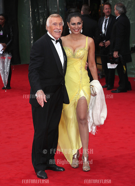 Bruce Forsyth and Wilnelia Merced arriving for the TV BAFTA Awards 2013, Royal Festival Hall, London. 12/05/2013 Picture by: Alexandra Glen / Featureflash