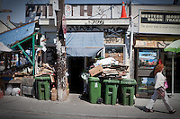 Trash bin are lined up and card box are piled up by a fruit store in Toronto Kensington Market April 23, 2010.  With eclectic shops, cafes and other attractions, Kensington Market is a distinctive multicultural neighbourhood in downtown Toronto, Ontario.