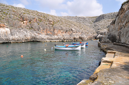 "Harbors around Malta are home to a kaleidoscope of vibrantly-painted boats at rest in brilliant turquoise waters.  The bows of many are adorned with the ""Eyes of Osiris."""