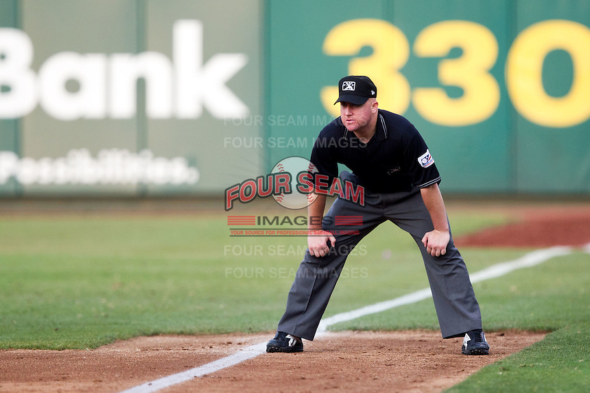 First Base Umpire Ryan Blakney watches down the first base line during a game between the Northwest Arkansas Naturals and the Springfield Cardinals at Hammons Field on July 30, 2011 in Springfield, Missouri. Springfield defeated Northwest Arkansas 11-5. (David Welker / Four Seam Images)