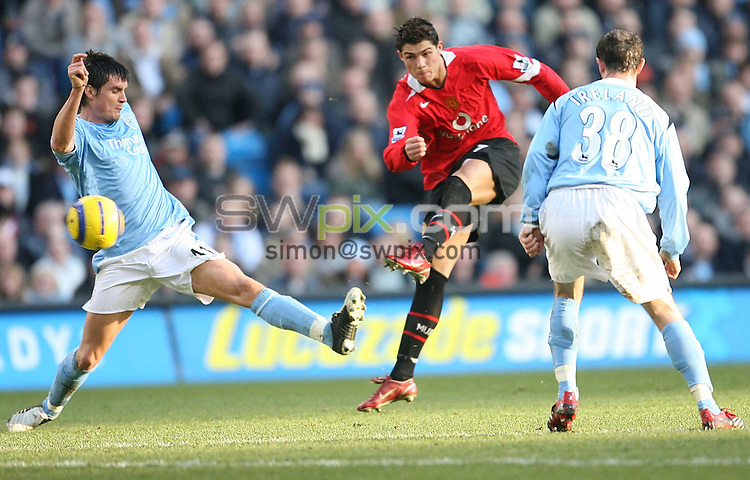 Pix by JOHN CLIFTON/SWpix.com - F.A. Barclays Premiership, Manchester City v Manchester United, The City of Manchester Stadium, Manchester... 14/01/06..Picture Copyright >> Simon Wilkinson >> 07811267706..United's Cristiano Ronaldo gets a shot away at goal