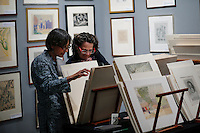 New York City, NY. 06 November 2014. Women observes an artwork during the IFPDA Print Fair, at the Park Avenue Armory in new york