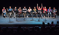 """On stage from left to right:<br /> Matilda """"Tiggy"""" Bayley '19; Jonny Rodgers '11; Carie Kawa '99; Allison Schreuder '18; Jim Delgado '18; Maricela Guardado '17; Toyin Moses '02; Kenyon Meleney '16; Sam Collins '19; Sandy Nguyen '21; Will Youmans '20.<br /> In honor of its 20th anniversary, the 2018 festival culminated with a concert reading of 20 mini scripts penned by Oxy theater alums who currently write for theater, film, television and the web. The resulting plays were performed by student and alumni actors who celebrated afterward with an after-party, Feb. 25, 2018 in Keck Theater.<br /> <br /> Alumni plays were created by Gladys Eva Angle '11, Brandon Baruch '07, Karen Baughn '08, Soren Bowie '04, Nina Carlin '15, Joe Chandler '01, Courtney Dusenberry '10, Kirsten Easton '13, Zee Echo Eskeets '07, Maricela Guardado '17, Hilly Hicks '92, Jeff Kauffmann '01, Winston A. Marshall '10, Laural Meade '88, Rachel Noll '08, Erik Patterson '00, Claudia Restrepo '10, Anne Garcia Romero '86, Marvin Solomon '00, Tristan Waldron '12.<br /> <br /> For 20 years, the Occidental New Play Festival (produced by associate professor of theatre Laural Meade '88) has paired student playwrights and actors with professional guest directors and performers. Focused on writer-centric rehearsal and performance, the festival provides a real-world experience of new play development as it is practiced on the national level. Through close collaboration with Los Angeles working artists, students experience a unique process unlike other college writing programs for the theater.<br /> (Photo by Marc Campos, Occidental College Photographer)"""