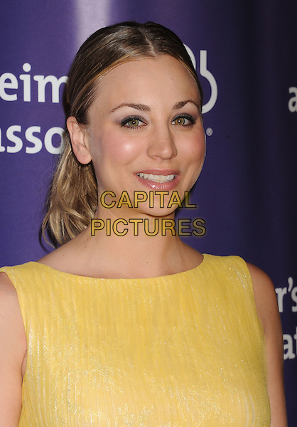 "Kaley Cuoco.arriving at the 20th Anniversary Alzheimer's Association ""A Night At Sardi's"" at The Beverly Hilton Hotel in Beverly Hills, California, USA, .March 21st, 2012..portrait headshot yellow.CAP/ROT/TM.©TM/Roth Stock/Capital Pictures"