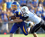 BROOKINGS, SD - AUGUST 31:  Jimmie Forsythe #25 from South Dakota State University tries to shake the grasp of Ian Dobek #19 from Butler in the first quarter Saturday evening at Coughlin Alumni Stadium in Brookings. (Photo by Dave Eggen/Inertia)