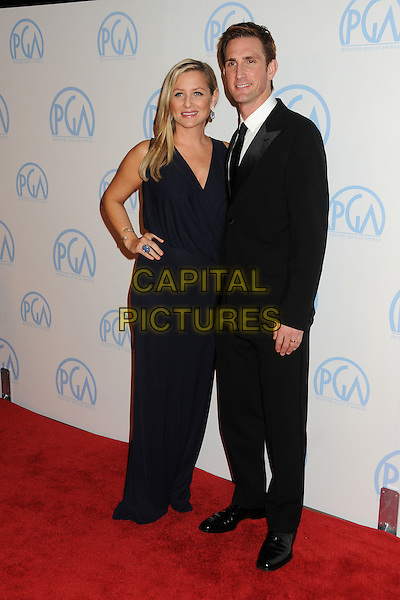 Jessica Capshaw & Christopher Gavigan .23rd Annual Producers Guild Awards held at the Beverly Hilton Hotel, - Beverly Hills, California, USA, .21st January 2012..full length dress sleeveless long maxi   navy blue married husband wife black suit tie hand on hip pregnant .CAP/ADM/BP.©Byron Purvis/AdMedia/Capital Pictures.
