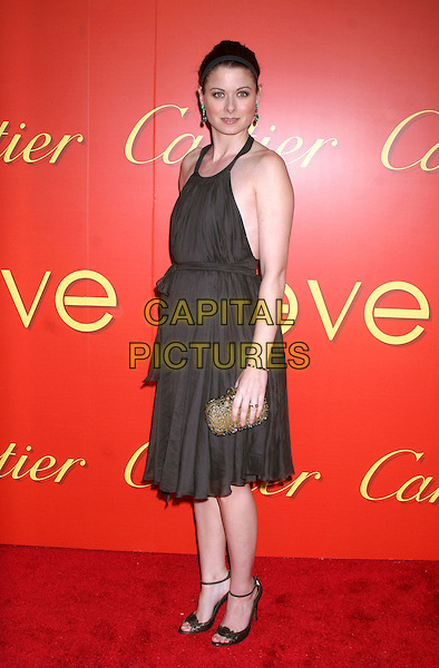 DEBRA MESSING .At the Cartier's Celebration of the Cartier Charity Love Bracelet at the The Cartier Mansion, New York, NY, USA..June 7th, 2007 .full length brown halterneck dress clutch purse alice band headband .CAP/IW.©Ian Wilson/Capital Pictures
