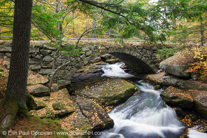 Gleason Falls Bridge which spans Beard Brook in Hillsborough, New Hampshire during the autumn months.