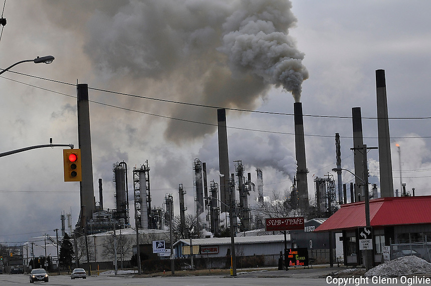 A fire at Imperial Oil's Sarnia Refinery forced emergency workers to shut down traffic in the Chemical Valley , on Friday February 13 2009. Flames were seen shooting from the coker unit of the plant.