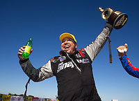 Sept. 22, 2013; Ennis, TX, USA: NHRA funny car driver Cruz Pedregon celebrates after winning the Fall Nationals at the Texas Motorplex. Mandatory Credit: Mark J. Rebilas-